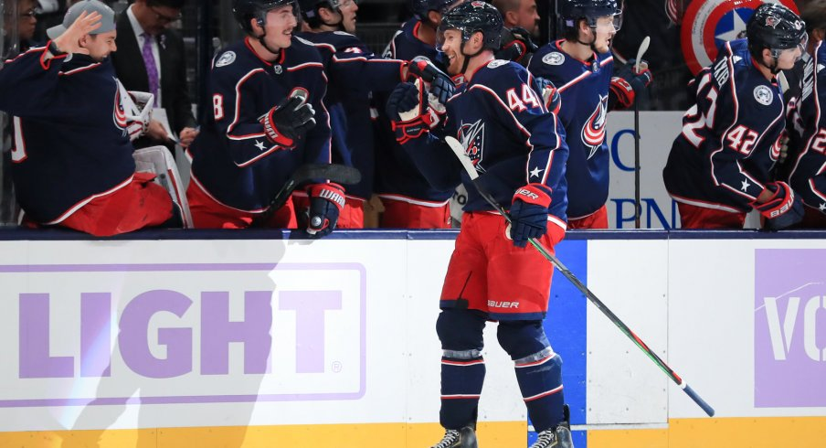 Nov 15, 2019; Columbus, OH, USA; Columbus Blue Jackets defenseman Vladislav Gavrikov (44) celebrates with teammates after scoring his first career goal in the game against the St. Louis Blues in the first period at Nationwide Arena. Mandatory Credit: Aaron Doster-USA TODAY Sports