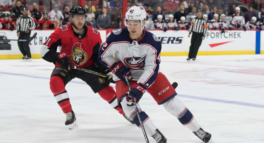 Apr 6, 2019; Ottawa, Ontario, CAN; Columbus Blue Jackets center Alexandre Texier (42) skates wit hthe puck in front of Ottawa Senators center Chris Tierney (71) in the first period at the Canadian Tire Centre.