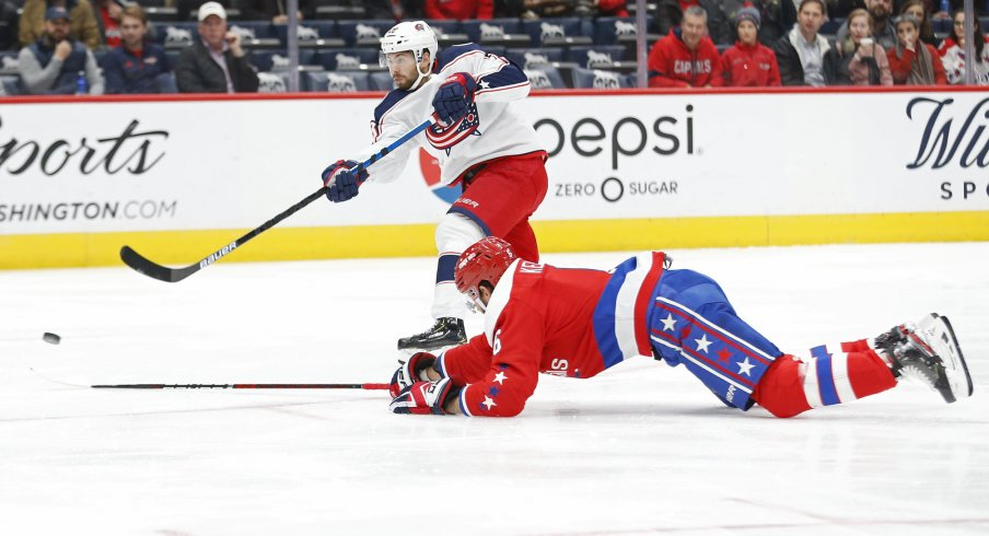 Dec 9, 2019; Washington, DC, USA; Columbus Blue Jackets right wing Oliver Bjorkstrand (28) shoots the puck as Washington Capitals defenseman Michal Kempny (6) defends in the first period at Capital One Arena. Mandatory Credit: Geoff Burke-USA TODAY Sports