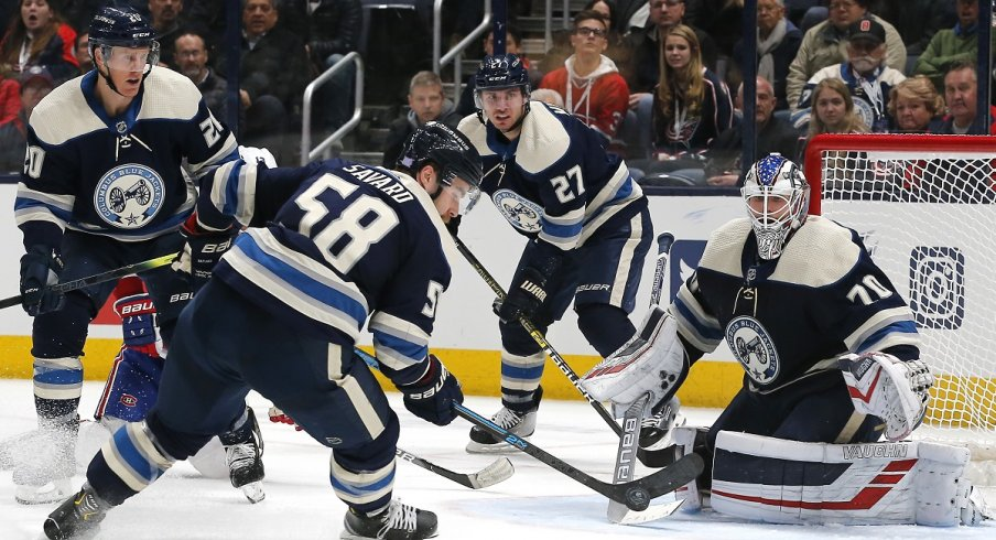 David Savard and Ryan Murray keep the puck out of the net