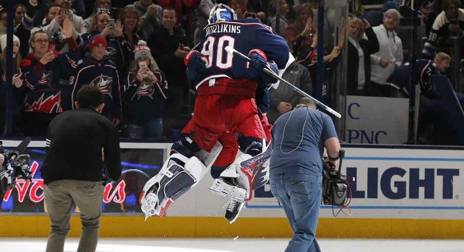 Columbus Blue Jackets goalie Elvis Merzlikins (90) and left wing Nick Foligno (71) celebrate the win after the game against the Florida Panthers at Nationwide Arena.