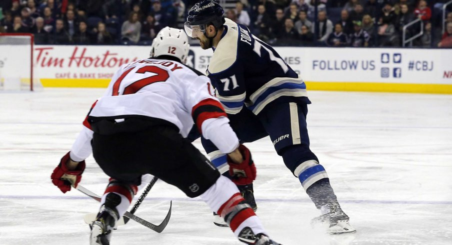 Dec 20, 2018; Columbus, OH, USA; Columbus Blue Jackets left wing Nick Foligno (71) passes the puck as New Jersey Devils defenseman Ben Lovejoy (12) defends during the second period at Nationwide Arena.