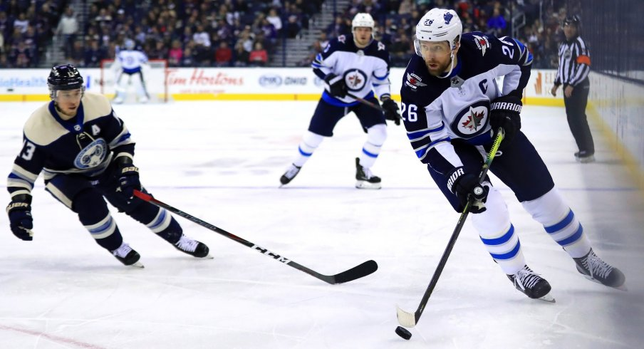 Mar 3, 2019; Columbus, OH, USA; Winnipeg Jets right wing Blake Wheeler (26) skates with the puck against the Columbus Blue Jackets in the first period at Nationwide Arena.