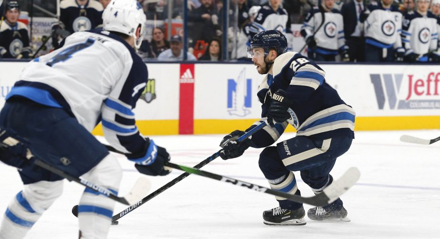 an 22, 2020; Columbus, Ohio, USA; Columbus Blue Jackets right wing Oliver Bjorkstrand (28) passes the puck against the Winnipeg Jets during the second period at Nationwide Arena.