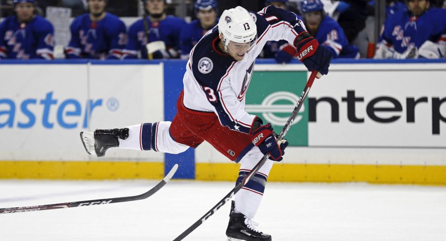 Jan 19, 2020; New York, New York, USA; Columbus Blue Jackets right wing Cam Atkinson (13) takes a shot during the first period against the New York Rangers at Madison Square Garden.