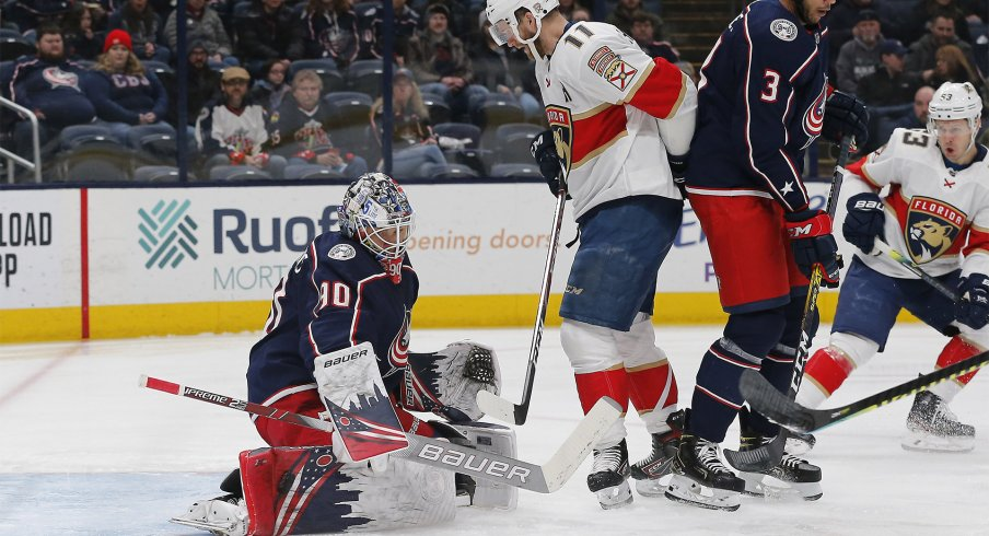 Columbus Blue Jackets goalie Elvis Merzlikins (90) makes a pad save as Florida Panthers left wing Jonathan Huberdeau (11) looks for a rebound during the first period at Nationwide Arena.