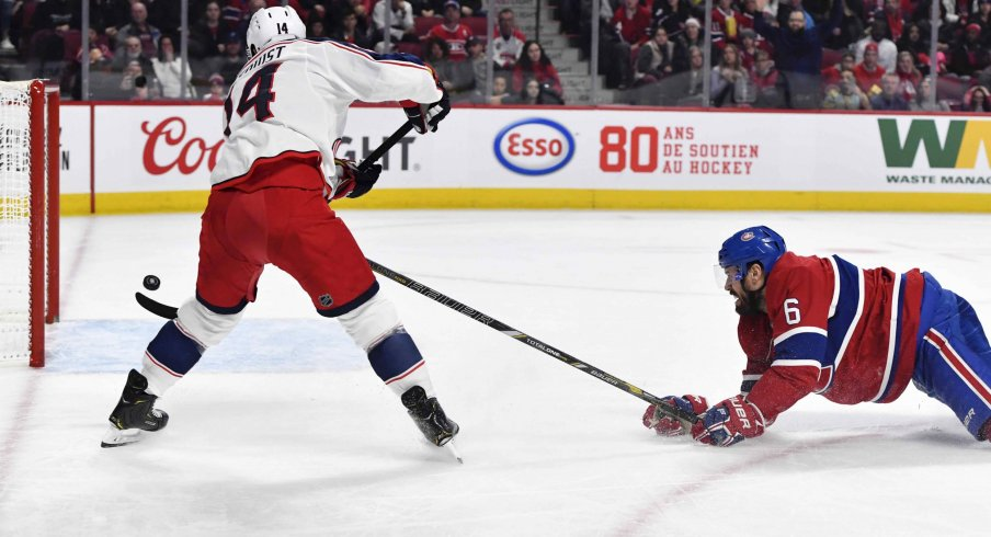 Feb 2, 2020; Montreal, Quebec, CAN; Columbus Blue Jackets forward Gustav Nyquist (14) scores a goal and Montreal Canadiens defenseman Shea Weber (6) defends during the third period at the Bell Centre.