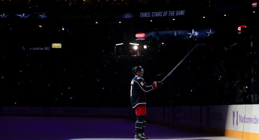 Columbus Blue Jackets defenseman Zach Werenski (8) skates on the ice for being named a star of the game, after scoring the game winning goal against the St. Louis Blues in the overtime period at Nationwide Arena.