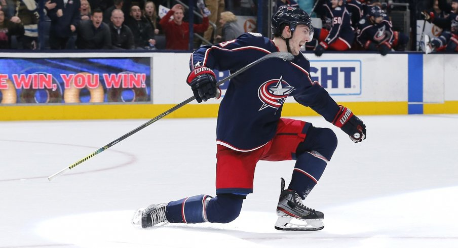 Zach Werenski celebrates after scoring the winning goal against the Florida Panthers during overtime at Nationwide Arena