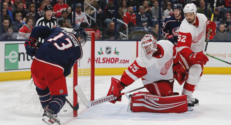 Columbus Blue Jackets right wing Cam Atkinson (13) scores a goal against Detroit Red Wings goalie Jimmy Howard (35) during the second period at Nationwide Arena.