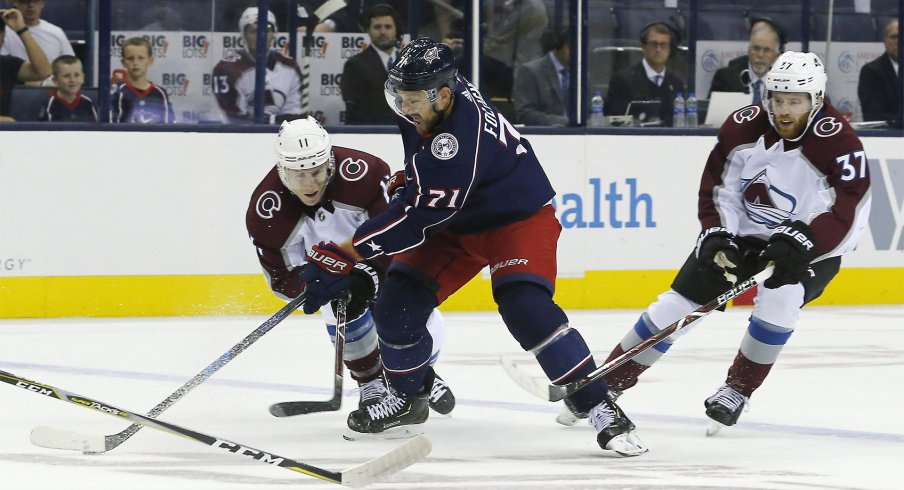 Oct 9, 2018; Columbus, OH, USA; Columbus Blue Jackets left wing Nick Foligno (71) stick handles past Colorado Avalanche left wing Matt Calvert (11) during the first period at Nationwide Arena.