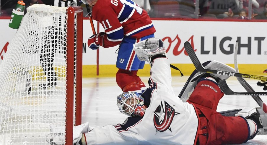 Feb 2, 2020; Montreal, Quebec, CAN; Columbus Blue Jackets goalie Elvis Merzlikins (90) makes a save against Montreal Canadiens forward Brendan Gallagher (11) during the second period at the Bell Centre.