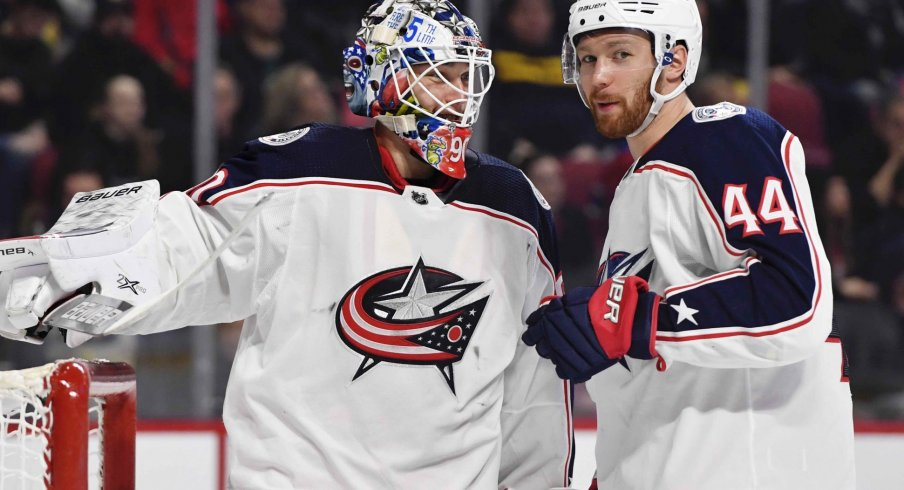 Feb 2, 2020; Montreal, Quebec, CAN; Columbus Blue Jackets goalie Elvis Merzlikins (90) and teammate Vladislav Gavrikov (44) during the second period of the game against the Montreal Canadiens at the Bell Centre.