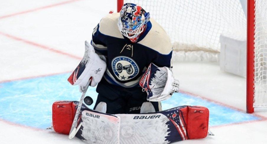 Columbus Blue Jackets goaltender Elvis Merzlikins makes a save against the Tampa Bay Lightning.