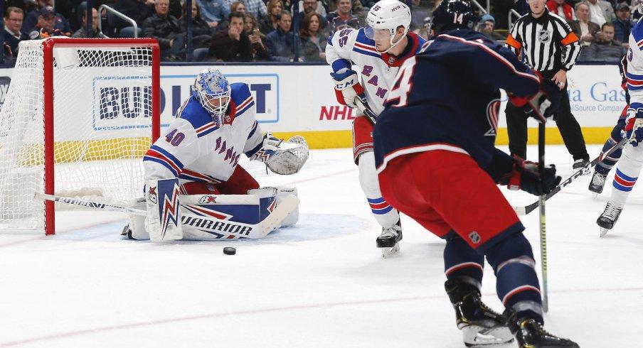 Columbus Blue Jackets forward Gustav Nyquist (14) puts the puck on goal against New York Rangers goaltender Alexandar Georgiev at Nationwide Arena.