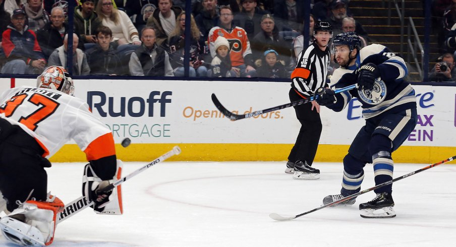 Nov 27, 2019; Columbus, OH, USA; Philadelphia Flyers goalie Brian Elliott (37) makes a save against Columbus Blue Jackets right wing Oliver Bjorkstrand (28) during the second period at Nationwide Arena.