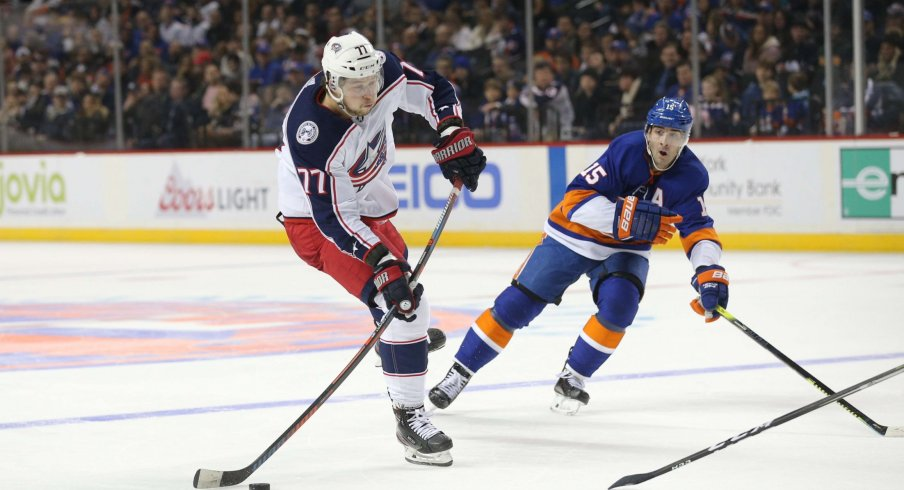 Nov 30, 2019; Brooklyn, NY, USA; Columbus Blue Jackets right wing Josh Anderson (77) shoots against New York Islanders right wing Cal Clutterbuck (15) during the third period at Barclays Center.