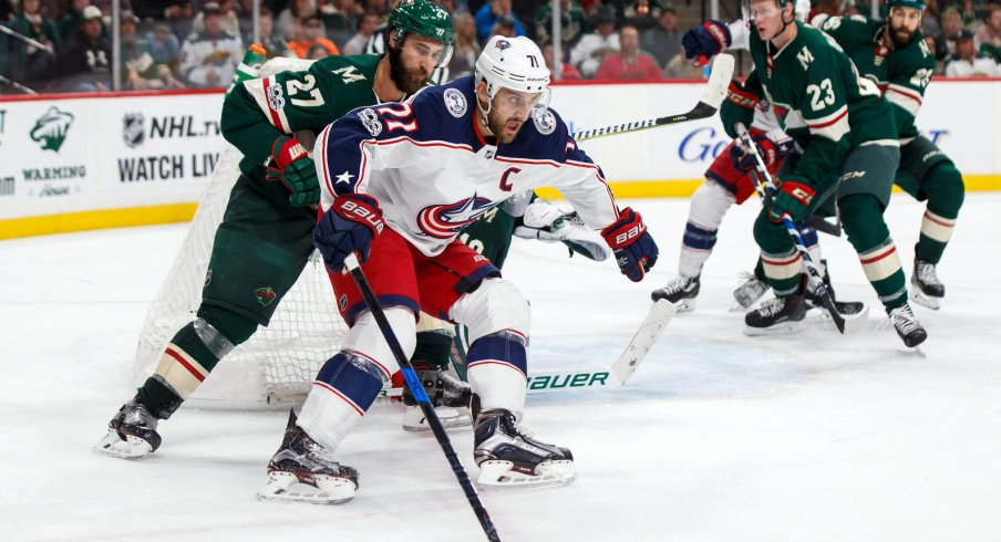 Oct 14, 2017; Saint Paul, MN, USA; Columbus Blue Jackets forward Nick Foligno (71) skates with the puck in the third period against the Minnesota Wild defenseman Kyle Quincey (27) at Xcel Energy Center. Mandatory Credit: Brad Rempel-USA TODAY Sports