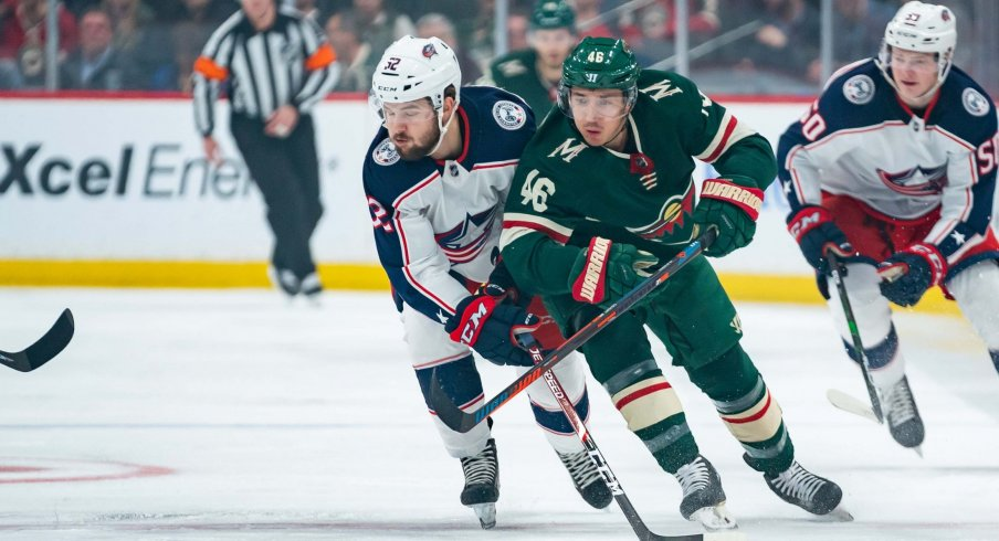 Feb 25, 2020; Saint Paul, Minnesota, USA; Minnesota Wild defenseman Jared Spurgeon (46) and Columbus Blue Jackets forward Emil Bemstrom (52) skate after the puck in the first period at Xcel Energy Center.