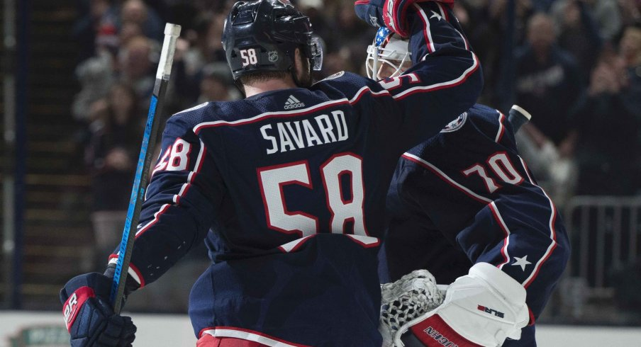Columbus, Ohio, USA; Columbus Blue Jackets goaltender Joonas Korpisalo (70) is congratulated by center Stefan Matteau (23) after their win against the Vancouver Canucks at Nationwide Arena.