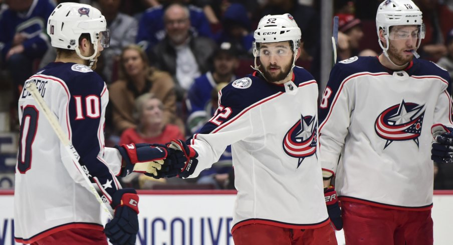 Mar 8, 2020; Vancouver, British Columbia, CAN; Columbus Blue Jackets forward Emil Bemstrom (52) celebrates his goal against Vancouver Canucks goaltender Thatcher Demko (35) (not pictured) with Columbus Blue Jackets forward Alexander Wennberg (10) during the second period at Rogers Arena. Mandatory Credit: Anne-Marie Sorvin-USA TODAY Sports