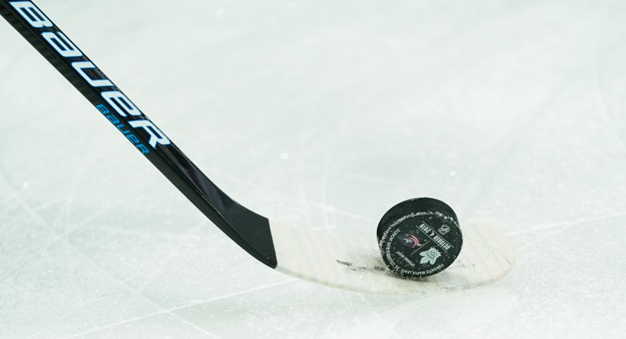 Oct 4, 2019; Columbus, OH, USA; A view of the Opening Night puck on the ice prior to the game between the Toronto Maple Leafs and the Columbus Blue Jackets at Nationwide Arena.