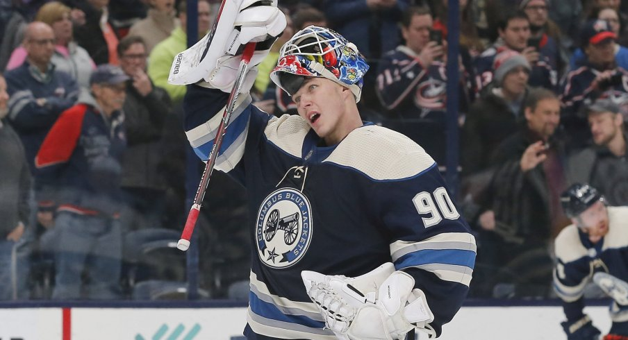 Columbus Blue Jackets goalie Elvis Merzlikins (90) during third period \time out against the Winnipeg Jets at Nationwide Arena.