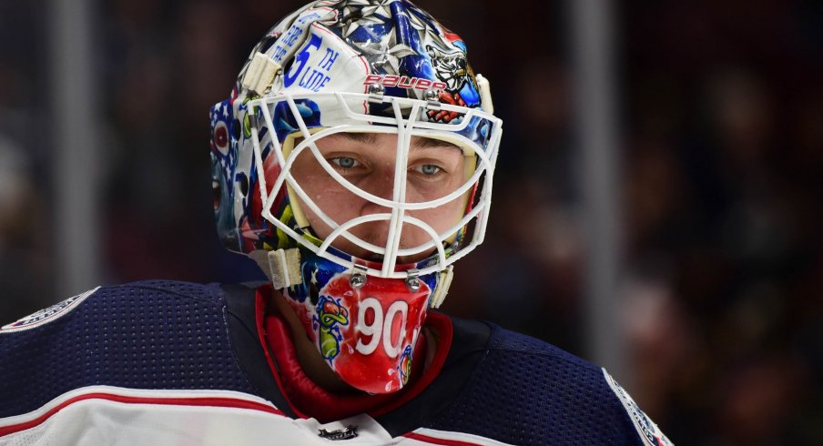 Mar 8, 2020; Vancouver, British Columbia, CAN; Columbus Blue Jackets goaltender Elvis Merzlikins (90) awaits the start of play against the Vancouver Canucks during the first period at Rogers Arena.