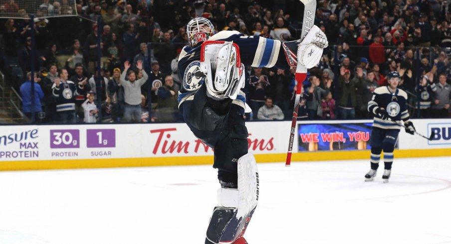 Jan 14, 2020; Columbus, Ohio, USA; Columbus Blue Jackets goalie Elvis Merzlikins (90) celebrates the win after the game with the Boston Bruins at Nationwide Arena.