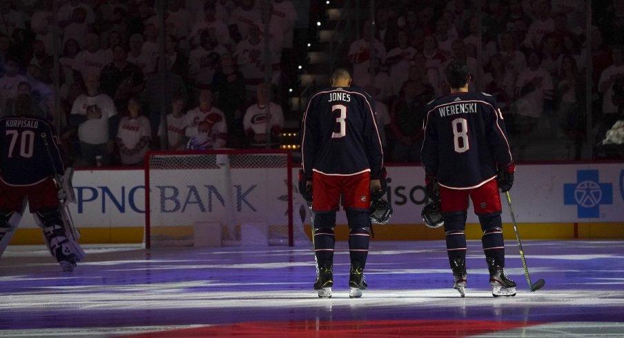 Zach Werenski and Seth Jones during the National Anthem