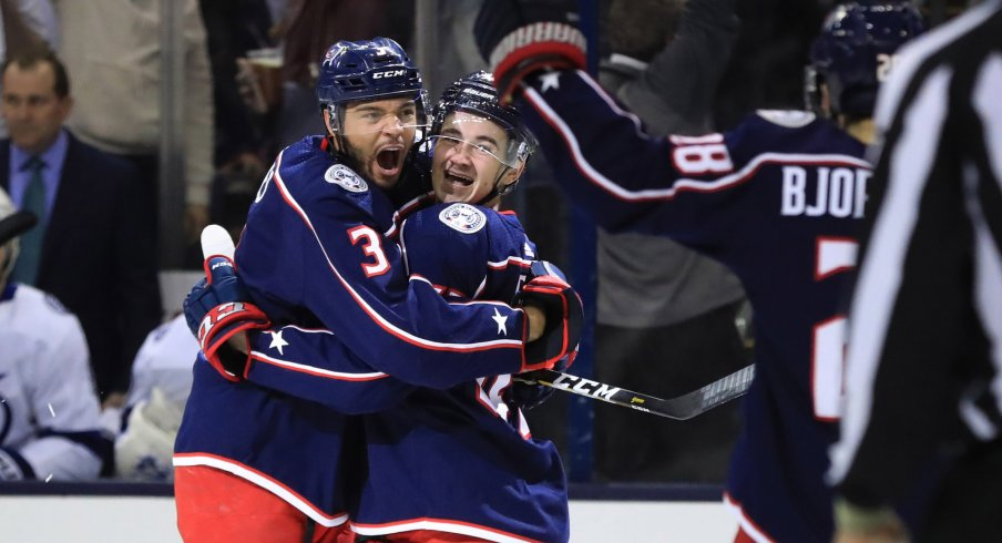 Columbus Blue Jackets defenseman Seth Jones (3) celebrates the goal scored by center Alexandre Texier (right) against the Tampa Bay Lightning in the first period during game four of the first round of the 2019 Stanley Cup Playoffs at Nationwide Arena.
