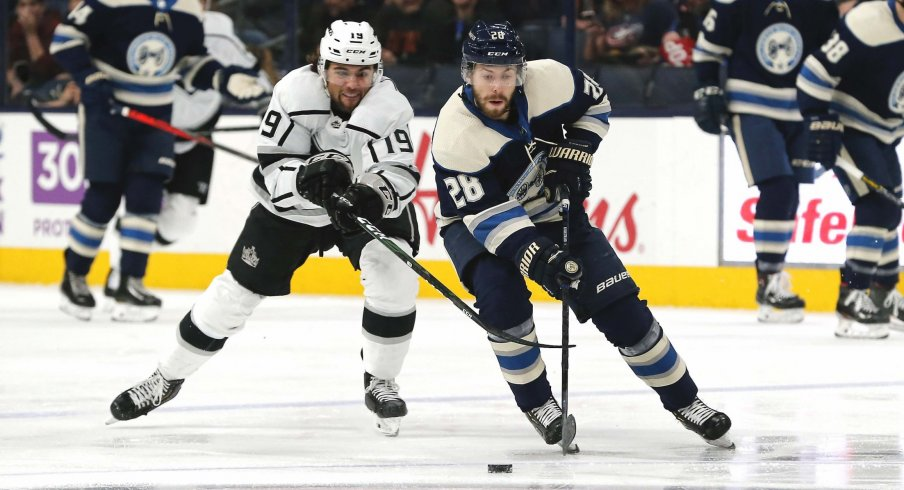 Dec 19, 2019; Columbus, OH, USA; Columbus Blue Jackets right wing Oliver Bjorkstrand (28) skates with the puck as Los Angeles Kings left wing Alex Iafallo (19) defends during the first period at Nationwide Arena.