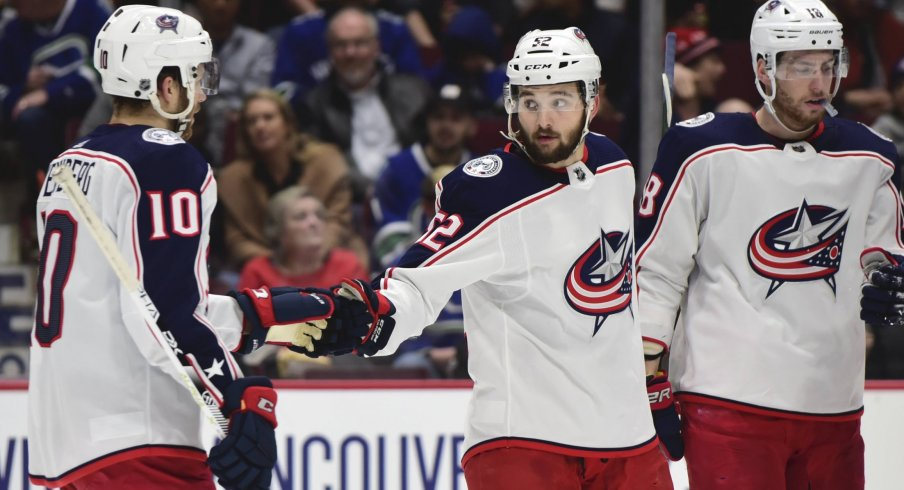 Mar 8, 2020; Vancouver, British Columbia, CAN; Columbus Blue Jackets forward Emil Bemstrom (52) celebrates his goal against Vancouver Canucks goaltender Thatcher Demko (35) (not pictured) with Columbus Blue Jackets forward Alexander Wennberg (10) during the second period at Rogers Arena.