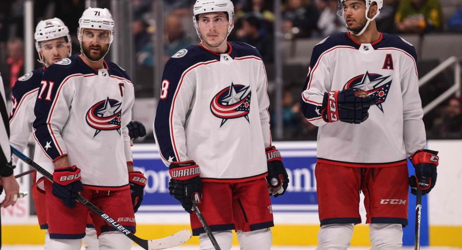 Jan 9, 2020; San Jose, California, USA; Columbus Blue Jackets left wing Nick Foligno (71) and defenseman Zach Werenski (8) and defenseman Seth Jones (3) react during the third period against the San Jose Sharks at SAP Center at San Jose.