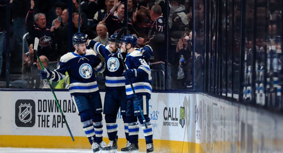 Columbus Blue Jackets left wing Nick Foligno (middle) celebrates with teammate center Pierre-Luc Dubois (left) and right wing Oliver Bjorkstrand (right) after scoring a goal against the Philadelphia Flyers in the first period at Nationwide Arena.