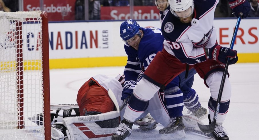 David Savard clears a rebound away from Andreas Johnsson