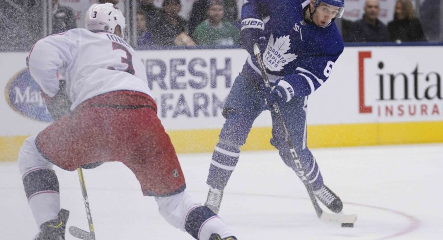 Toronto Maple Leafs forward Ilya Mikheyev (65) shoots the puck against Columbus Blue Jackets defenseman Seth Jones (3) at Scotiabank Arena. Columbus defeated Toronto in overtime.