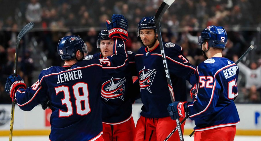 Columbus Blue Jackets defenseman Seth Jones (middle) celebrates with teammates \after scoring a goal against the Colorado Avalanche in the second period at Nationwide Arena.