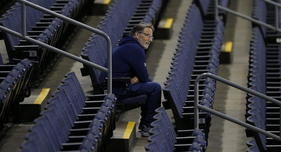 John Tortorella watches his team practice from the stands