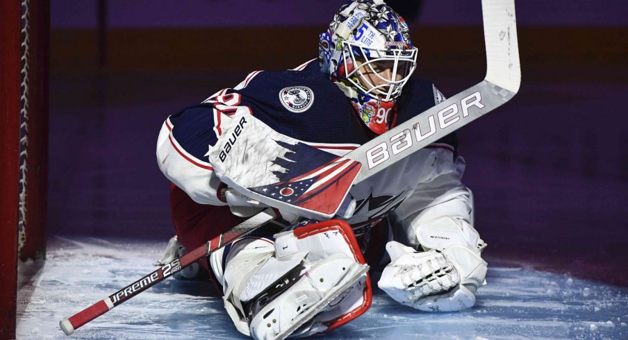 Columbus Blue Jackets goalie Elvis Merzlikins (90) stretches during the second period of the game against the Montreal Canadiens at the Bell Centre.