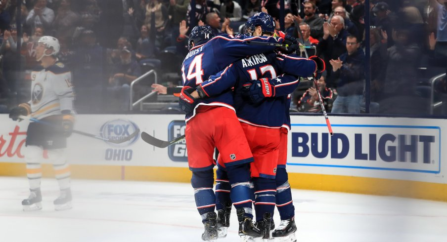 The Columbus Blue Jackets celebrate after scoring a power play goal against the Buffalo Sabres at Nationwide Arena.