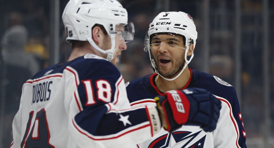 Columbus Blue Jackets center Pierre-Luc Dubois (18) celebrates with defenseman Seth Jones (3) after scoring the game winning goal during the overtime period against the Boston Bruins at TD Garden.