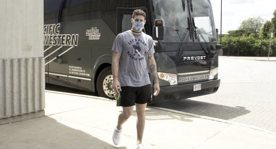 "Pierre-Luc Dubois arrives at Scotiabank Arena in Toronto wearing a HOMAGE-branded ""Let's Play Bubble Hockey"" t-shirt."