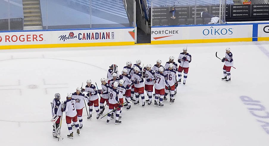 The Columbus Blue Jackets celebrate their Game 1 win over Toronto.