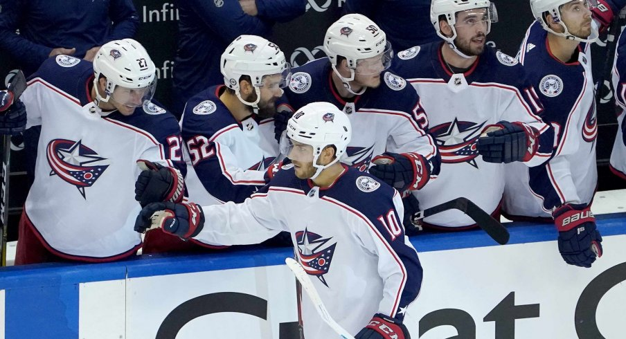 Aug 2, 2020; Toronto, Ontario, CANADA; Alexander Wennberg #10 of the Columbus Blue Jackets celebrates his empty net goal with teammates on the bench in the third period against the Toronto Maple Leafs in Game One of the Eastern Conference Qualification Round prior to the 2020 NHL Stanley Cup Playoffs at Scotiabank Arena on August 02, 2020 in Toronto, Ontario, Canada.