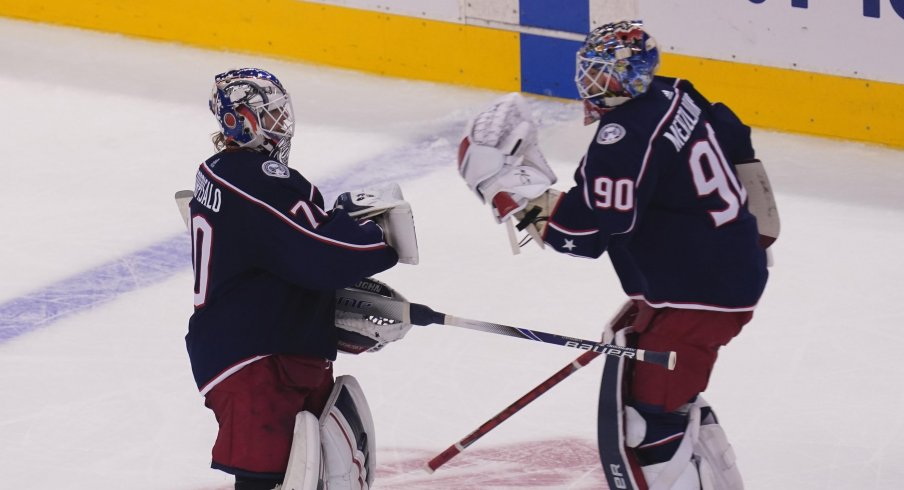 Columbus Blue Jackets goaltender Joonas Korpisalo (70) heads for the bench as he is replaced by goaltender Elvis Merzlikins (90) during the second period against the Toronto Maple Leafs in the Eastern Conference qualifications at Scotiabank Arena.