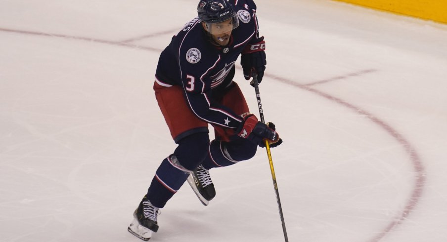 \Columbus Blue Jackets defenseman Seth Jones (3)carries the puck against the Toronto Maple Leafs during overtime of Eastern Conference qualifications at Scotiabank Arena.