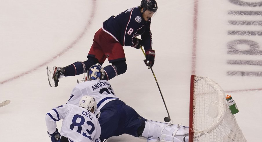 Columbus Blue Jackets defenseman Zach Werenski (8) tries to get a shot on Toronto Maple Leafs goaltender Frederik Andersen (31) during overtime of Eastern Conference qualifications at Scotiabank Arena.