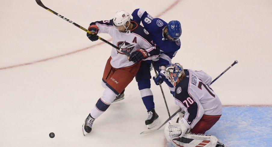 Aug 11, 2020; Toronto, Ontario, CAN; Tampa Bay Lightning right wing Nikita Kucherov (86) and Columbus Blue Jackets defenseman Seth Jones (3) battle for the puck in front of Blue Jackets goaltender Joonas Korpisalo (70) in the first overtime in game one of the first round of the 2020 Stanley Cup Playoffs at Scotiabank Arena.