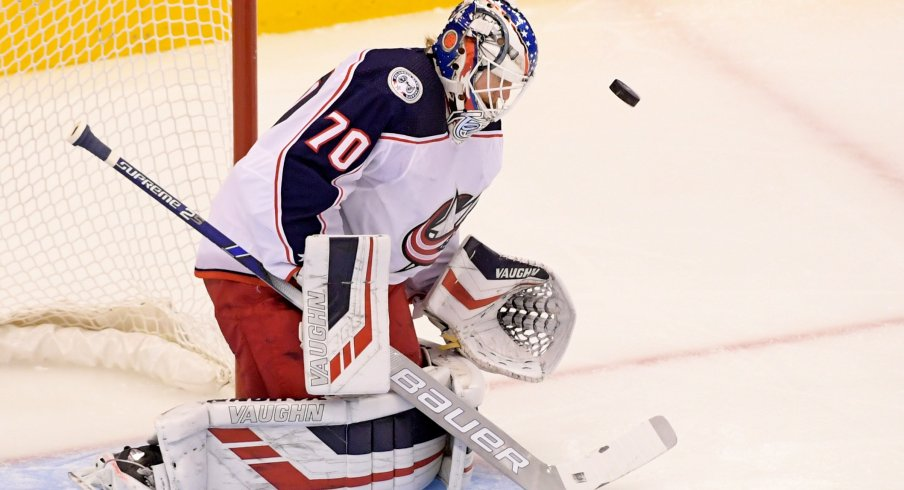 Columbus Blue Jackets goaltender Joonas Korpisalo (70) makes a save against the Tampa Bay Lightning during the first period in game two of the first round of the 2020 Stanley Cup Playoffs at Scotiabank Arena.